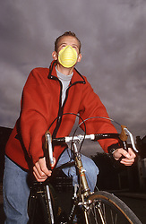 Male cyclist wearing face mask riding bicycle,
