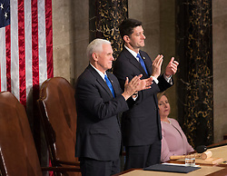 United States Vice President Mike Pence (left) and Speaker of The House of Representatives Paul Ryan (right) applaud during an address by U.S. President Donald J. Trump to a joint session of Congress on Capitol Hill in Washington, DC, USA, February 28, 2017. Photo by Chris Kleponis/CNP/ABACAPRESS.COM