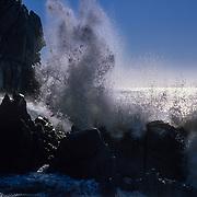 Wave crashing on rocks. Cabo San Lucas. BCS, Mexico.