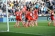 Rickie Lambert of Southampton is congratulated by his team mates as they  celebrate his injury time goal..<br /> Barclays Premier league match, Swansea city v Southampton at the Liberty stadium in Swansea, South Wales on Saturday 3rd May 2014.<br /> pic by Phil Rees, Andrew Orchard sports photography.