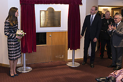 The Duke and Duchess of Cambridge unveil a plaque during a visit to Francis House hospice in Manchester.
