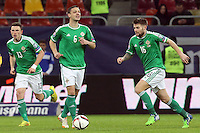 ROMANIA, Bucharest : Northern Ireland's Corry Evans (L), Chris Baird (C) and Oliver Norwood (R)during the Euro 2016 Group F qualifying football match Romania vs Northern Ireland in Bucharest, Romania on November 14, 2014.