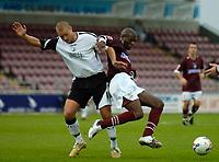 Photo: Daniel Hambury.<br />Northampton Town v Swansea City. Coca Cola League 1. 28/10/2006.<br />Northampton's Ian Taylor (R) and Swansea's Lee Trundle battle.