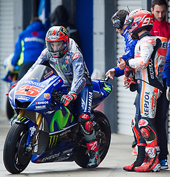 October 21, 2017 - Melbourne, Victoria, Australia - Spanish rider Maverick Viñales (#25) of Movistar Yamaha MotoGP leaves his garage as Spanish rider Marc Marquez (#93) of Repsol Honda Team (L) looks on as he walks back to his garage after coming off his bike during the third free practice session at the 2017 Australian MotoGP at Phillip Island, Australia. (Credit Image: © Theo Karanikos via ZUMA Wire)