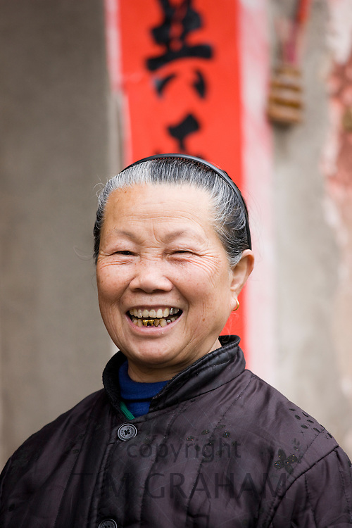 Elderly Chinese woman in Fuli Old Town, Xingping, China