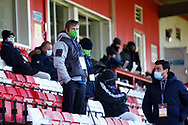 Ground Shot of socially distanced spectators who work for the club in their masks to protect against Covid 19 during the EFL Sky Bet League 2 match between Stevenage and Bradford City at the Lamex Stadium, Stevenage, England on 5 April 2021.