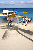 Mindoro Ferryboat to Puerto Galera - An outrigger is a part of a boat's rigging which is rigid and extends beyond the side or gunwale of a boat. The outrigger is positioned rigidly and parallel to the main hull so that the main hull is less likely to capsize. If only one outrigger is used on a vessel, its weight reduces the tendency to capsize in one direction and its buoyancy reduces the tendency in the other direction.