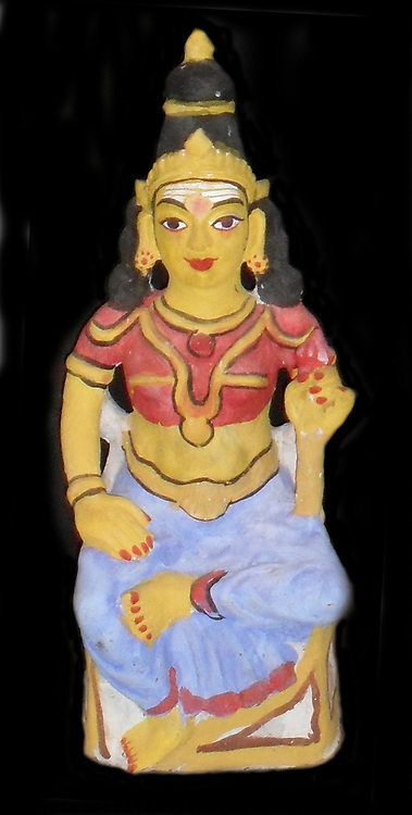 The Hindu God Brahma, represented as Saraswati (his consort.  Small statuette figure, from early 20th Century India.