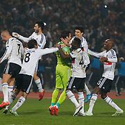 Besiktas's players celebrate victory during the UEFA Europa League Round of 32 second leg soccer match Besiktas between Liverpool at Ataturk Olimpiyat stadium in Istanbul Turkey on Thursday February 26, 2015. Photo by Aykut AKICI/TURKPIX