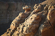 Detail of unusual rock formations caused by wind erosion on the rim of a canyon system near Factory Butte, Utah.