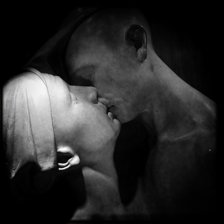 """""""The Kiss"""". Plaster sculpture by Italian sculptor Francesco Ciusa exhibited at Tribu museum in Nuoro (Sardinia), Italy. 2014."""