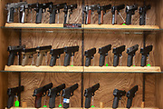 Gun shop in Burlington, near to Minot, North Dakota, Unted States. Many types of weapons are for sale here from basic shotguns and handguns to military type semi-automatics such as the M16. Guns and ammunition from this store are used by hunters and for protection.
