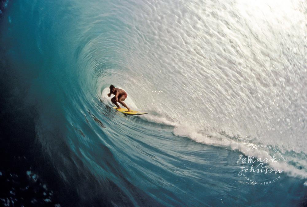 Surfer deep in a Bali tube, Kuta Beach, Bali, Indonesia ****Model Release available