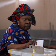 February 26, 2012 - Dakar, Senegal: A senegalese woman casts her vote for the senegalese presidential elections at a polling station in Franco-Arab School in Point E area of Dakar. Hundreds arriving for voting in the early hours. (Paulo Nunes dos Santos/Polaris)