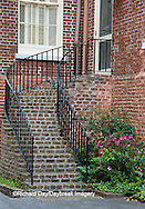 66512-00202 Iron staircase and azaleas on old brick building, Charleston, SC
