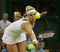 28.06.2011, Wimbledon, London, GBR, WTA Tour, Wimbledon Tennis Championships, im Bild Sabine Lisicki (GER) in action during the Ladies' Singles Quarter-Final match on day eight of the Wimbledon Lawn Tennis Championships at the All England Lawn Tennis and Croquet Club. EXPA Pictures © 2011, PhotoCredit: EXPA/ Propaganda/ David Rawcliffe +++++ ATTENTION - OUT OF ENGLAND/UK +++++ // SPORTIDA PHOTO AGENCY