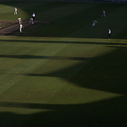 Western Australia bowl the last over over of the day as the shadows of the famous Members stand at the Sydney Cricket ground stretch across the pitch during day two of the Sheffield Shield Cricket match between New South Wales and Western Australia at the Sydney Cricket Ground, Sydney, Australia on March 6, 2009.   Photo Tim Clayton