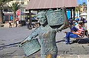Fisherman statue sculpture in harbour at fishing village of Marsaxlokk, Malta
