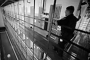 Officer Michael Bala waits to lift the handle that will lock the inmates in their cells.  The Bristol County Jail & House of Correction located on Ash Street in New Bedford, Massachusetts was started in 1829, and is the oldest running jail in the United States.   The Ash street jail, as it is known, has been a controversial facility since it opened.  It is believed to be the site of the last pubic hanging in Massachusetts sometime in the 1890's.  Two big riots broke out in the 90's (1993, 1998) and since then the facility has been modified to alleviate some of the crowded conditions that resulted in the riots.