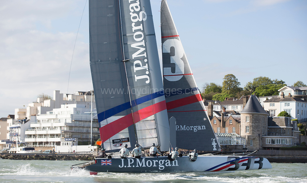 J.P.Morgan Asset Management Round the Island Race 2013.<br /> <br /> Picture shows Ben Ainslie skippering the J.P.Morgan BAR AC45 catamaran to a new course record of 2hrs 52mins 15sec. With team mates Matt Cornwell (GBR) Andrew Mills (GBR) Mark Andrews and (GBR) Andrew McLean (NZL)