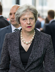 © Licensed to London News Pictures. 03/06/2018. London, UK. British Prime Minister Theresa May leaves after laying flowers to mark one year since the London Bridge and Borough Market terror attacks. A series of events have taken place throughout the day, including a service of commemoration at Southwark Cathedral, the planting of an olive tree in the Cathedral grounds, a minute's silence at 4:30pm and the laying of flowers.  Photo credit : Tom Nicholson/LNP