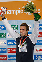 Svømming<br /> EM 2008<br /> Eindhoven<br /> 19.03.2008<br /> Foto: Wrofoto/Digitalsport<br /> NORWAY ONLY<br /> <br /> Alexander Dale Oen of Norway displays his gold medal after setting a European record in the men's 100m breaststroke finals at the European Swimming Championships
