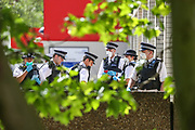 Police are seen briefing in a corridor of the yard of St Thomas' Hospital near A & E in central London after having arrested a person for medical reasons as mentioned by a member of St Thomas' Hospital security personnel. Office for National Statistics (ONS) confirmed on Tuesday, May 5, 2020, that more people have died in the United Kingdom from coronavirus than any other European country. (Photo/Vudi Xhymshiti)