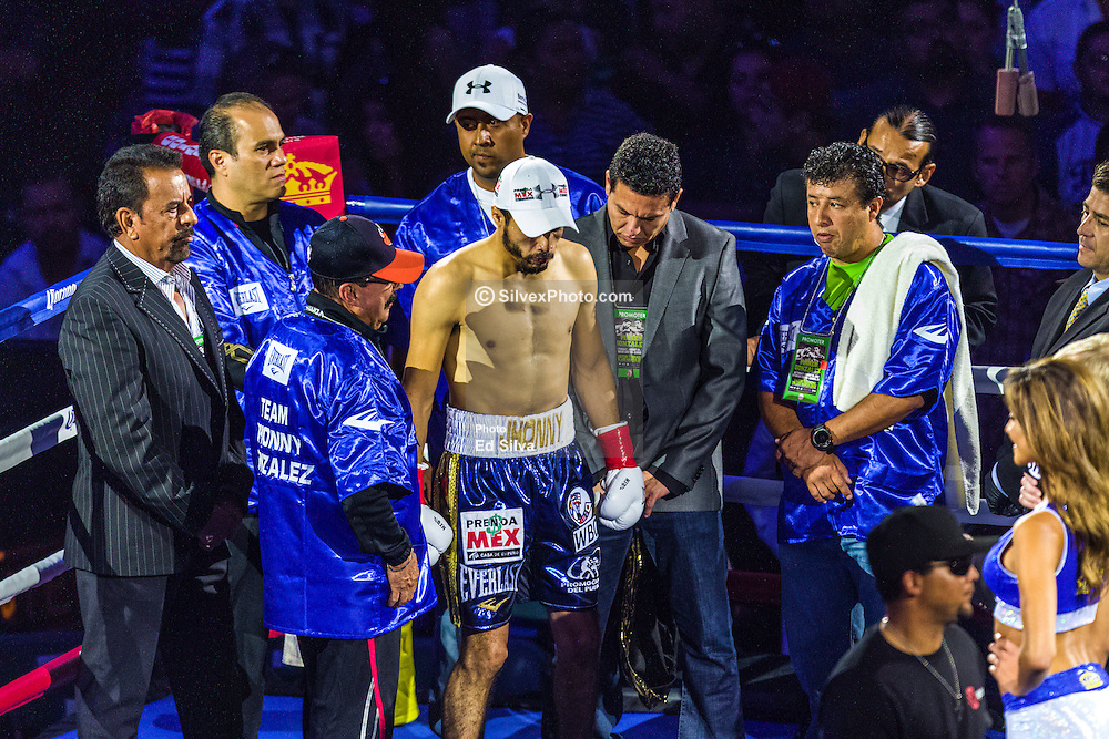 CARSON, California/USA (Saturday, Aug 24 2013) -  Jhonny Gonzales takes orders from his trainer hall of famer Nacho Beristain moments before the Mares vs Gonzalez bout. Mexican pro boxer Jhonny Gonzalez (55-8, 47 KOs) claimed the WBC Featherweight belt by TKO in the first round during his fight with Abner Mares (27-1-1, 14 KO's) at the StubHub Center (formerly Home Depot Center) in Carson, California USA. Jhonny (blue trunks) sent Abner Mares (black truncks) twice to the canvas in the first round. The main referee stopped the bout after the second knockdown at 2 minutes 55 seconds into the first  round. This is Abner first loss in his pro boxing career. August 24, 2013 in Carson, California. PHOTO © Eduardo E. Silva/SILVEXPHOTO.COM.