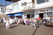 People sitting outside cafes Bridlington, Yorkshire, England