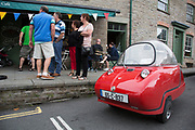"Rare Maserati vintage Peel Bubble Car parked outside a cafe in Hay-on-Wye or Y Gelli Gandryll in Welsh, known as ""the town of books"", is a small town in Powys, Wales famous for it's many second hand and specialist bookshops, although the number has declined sharply in recent years, many becoming general antique shops and similar."