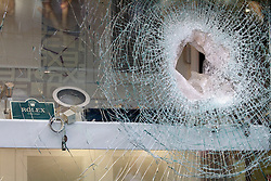 © Licensed to London News Pictures. 20/12/2011. London, United Kingdom .A smashed window of a Rolex watch shop after an attempted robbery on Oxford Street by persons on two motorbikes..Photo credit : Chris Winter/LNP