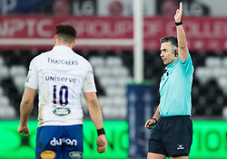 Referee Steve Lee awards a penalty<br /> <br /> Photographer Simon King/Replay Images<br /> <br /> Anglo-Welsh Cup Round 4 - Ospreys v Bath Rugby - Friday 2nd February 2018 - Liberty Stadium - Swansea<br /> <br /> World Copyright © Replay Images . All rights reserved. info@replayimages.co.uk - http://replayimages.co.uk