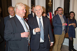 Left to right, STANLEY JOHNSON and LORD LAMONT at a reception to celebrate the publication of Quicksilver by HRH Princess Michael of Kent held at the home of Richard & Basia Briggs, 35 Sloane Gardens, London on 9th November 2015.