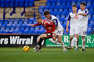 Walsall's Sam Mantom shields the ball from Tranmere Rovers Matthew Kennedy. Skybet football league 1 match, Tranmere Rovers v Walsall at Prenton Park in Birkenhead, England on Saturday 11th Jan 2014.<br /> pic by Chris Stading, Andrew Orchard sports photography.