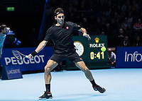 Tennis - 2019 Nitto ATP Finals at The O2 - Day One<br /> <br /> Singles Group Bjorn Borg: Roger Federer (Switzerland) vs. Dominic Thiem (Austria)<br /> <br /> Roger Federer (Switzerland) drives the forehand from the backline<br /> <br /> COLORSPORT/DANIEL BEARHAM