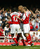 Photo. Chris Ratcliffe, Digitalsport<br /> Arsenal v Norwich City. Barclays Premiership. 02/04/2005<br /> Thierry Henry celebrates his second goal with Freddie Ljungberg and Lauren
