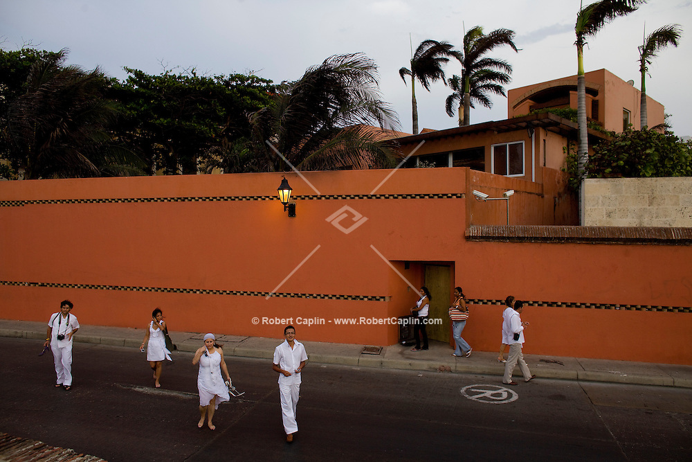 Author Gabriel García Márquez's home a rare act of architectural subversion in a city of architectural conformity. It is a modernist dwelling with an orange-red hue, cut in clean, straight lines. It is on the edge of the city, looking out at the sea, unlike the many homes of the old families here that lurk on quiet inside lanes in Cartagena, Colombia...Photo by Robert Caplin.