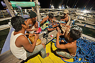 Bugis bagan fishers pass a ong night waiting for fish with acoustic dangdut music.