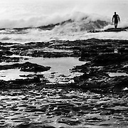 Surfer at the Cowrie Hole, a rocky surfbreak near Newcastle, Australia