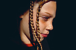 Side profile of young girl with hair in plaits,