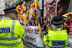 """London, September 21st 2015. Protests by Shugden Bhuddists who allege that the Dalai  Lama discriminates against their sect, protest outside the Lyceum Theatre in London as the Dalai Lama attends """"An Afternoon With The Dalai Lama And Friends"""" event as part of his UK visit. Loyalists staged a counter protest welcoming the Bhuddist leader to London. PICTURED: Police look on as  Shugden Bhuddists protest against the """"false"""" Dalai Lama."""