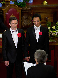 © Licensed to London News Pictures . 28/03/2014. London, UK.  Peter McGraith and David Cabreza become one of the first in the UK to marry under the new law tonight (29/03/14) at Islington Town Hall, east London. Photo credit: Isabel Infantes /LNP