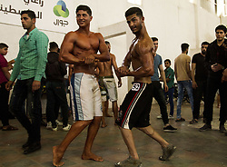 May 20, 2017 - Gaza City, The Gaza Strip, Palestine - Palestinian men compete during a bodybuilding contest in Gaza City. Some 30 men took part in the contest, while over 1000  people attended the event. Although not the first of its kind to be held in the Gaza Strip, bodybuilding contests are rare in the Hamas-controlled territory. (Credit Image: © Mahmoud Issa/Quds Net News via ZUMA Wire)