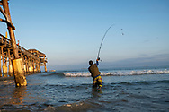 Cocoa Beach, Florida, USA - December 15, 2020: Amed Karimine, born and raised in Morocco, has lived most of his adult life in Florida, where he enjoys fishing regularly at the Cocoa Beach Pier.
