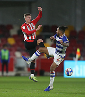 Brentford's Marcus Forss and Reading's Liam Moore<br /> <br /> Photographer Rob Newell/CameraSport<br /> <br /> The EFL Sky Bet Championship - Brentford v Reading - Saturday 19th December 2020 - Brentford Community Stadium - Brentford<br /> <br /> World Copyright © 2020 CameraSport. All rights reserved. 43 Linden Ave. Countesthorpe. Leicester. England. LE8 5PG - Tel: +44 (0) 116 277 4147 - admin@camerasport.com - www.camerasport.com