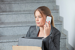 Businesswoman mobile phone fired jobless