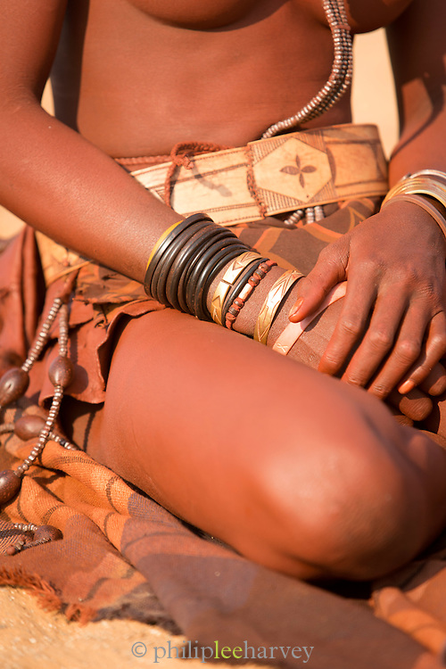 Detail of bracelets, Woman of the Himba Tribe, Kunene Region, Northern Namibia, Southern Africa