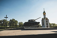 A Soviet T-34-85 tank, which was used during WWII, is now a monument at the Memorial of Glory in Tiraspol, Transnistria. On the right is the Chapel of St. George the Victorious.