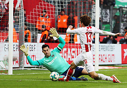 COLOGNE, Feb. 18, 2018  Philipp Tschauner (L), goalkeeper of Hannover and Yuya Osako of Koeln vie for the ball during the Bundesliga match between 1. FC Koeln and Hannover 96 in Cologne, Germany, on Feb. 17, 2018. The match ended with a tie 1-1. (Credit Image: © Ulrich Hufnagel/Xinhua via ZUMA Wire)