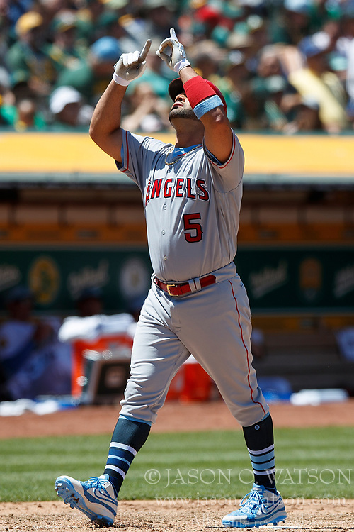 OAKLAND, CA - JUNE 17: Albert Pujols #5 of the Los Angeles Angels of Anaheim celebrates after hitting a home run against the Oakland Athletics during the sixth inning at the Oakland Coliseum on June 17, 2018 in Oakland, California. The Oakland Athletics defeated the Los Angeles Angels of Anaheim 6-5 in 11 innings. (Photo by Jason O. Watson/Getty Images) *** Local Caption *** Albert Pujols